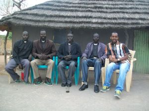 Joseph and I (extreme left & extreme right) with pastors from Agany